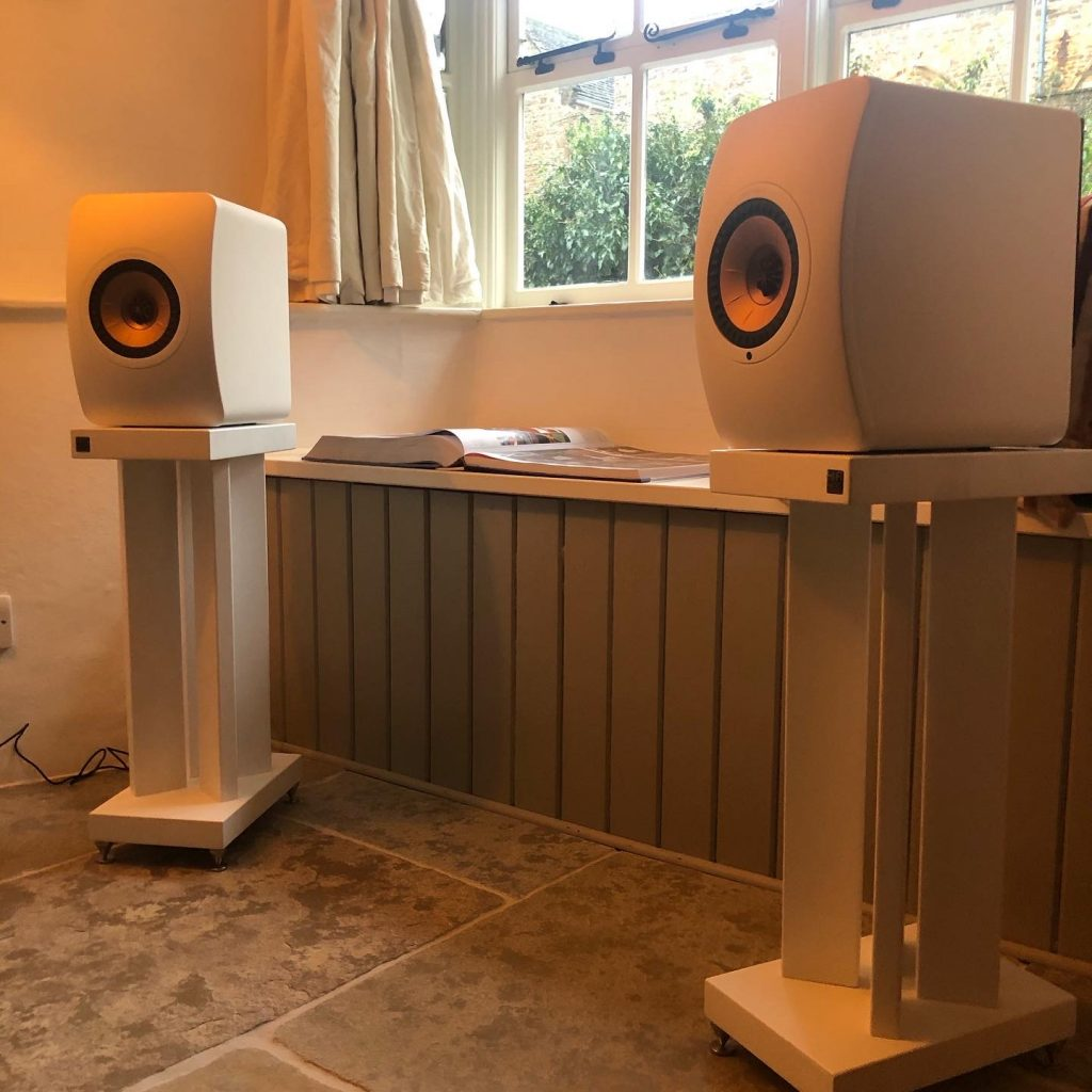Showing KEF LS50 Wireless II on Hi-Fi Racks' X50 Large stands in white satin